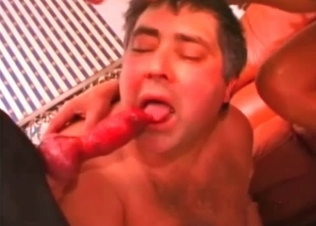Two gay dudes share this dog cock